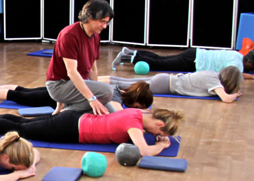 Pilates class, diamond press